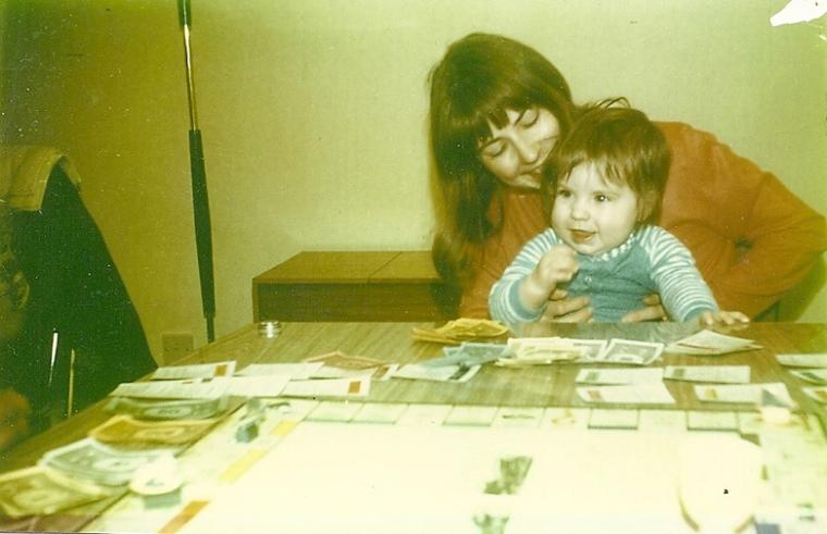 Toni playing monopoly with mum.