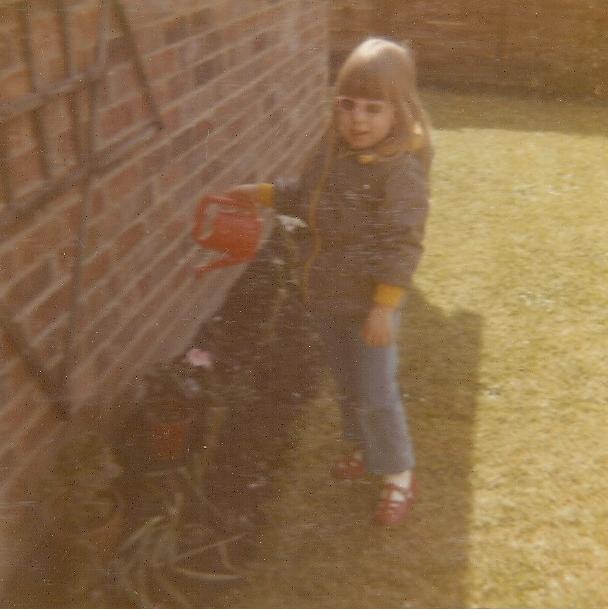 Toni watering the garden.